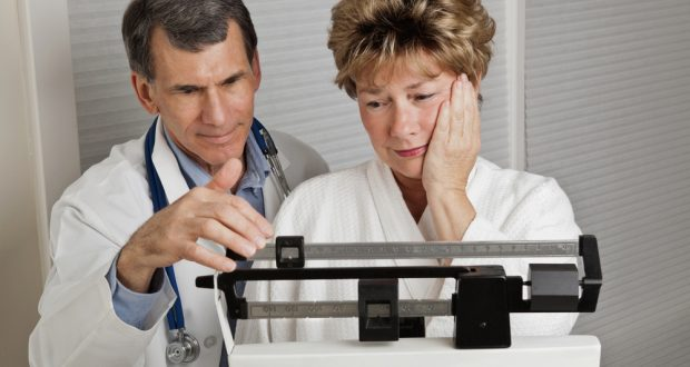 menopause-woman-and-doctor-on-scale